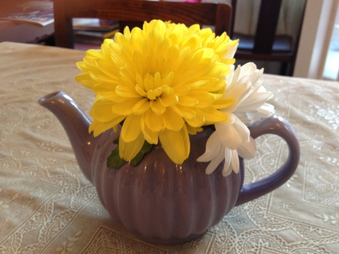 Teapot full of flowers
