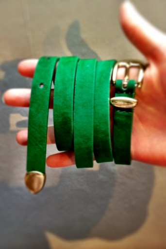 Green belt with gold buckle